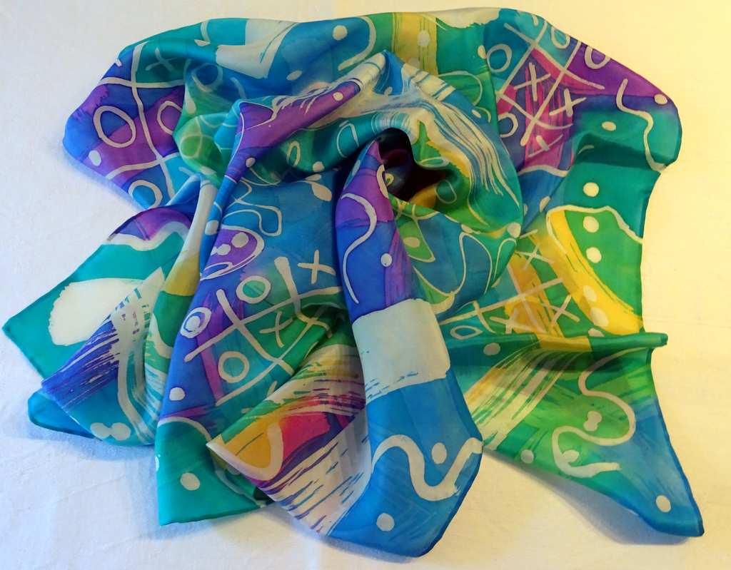 `Fiesta` (Square. 76cm x 78cm. Bright Colours with Batik Design. £45.00)
